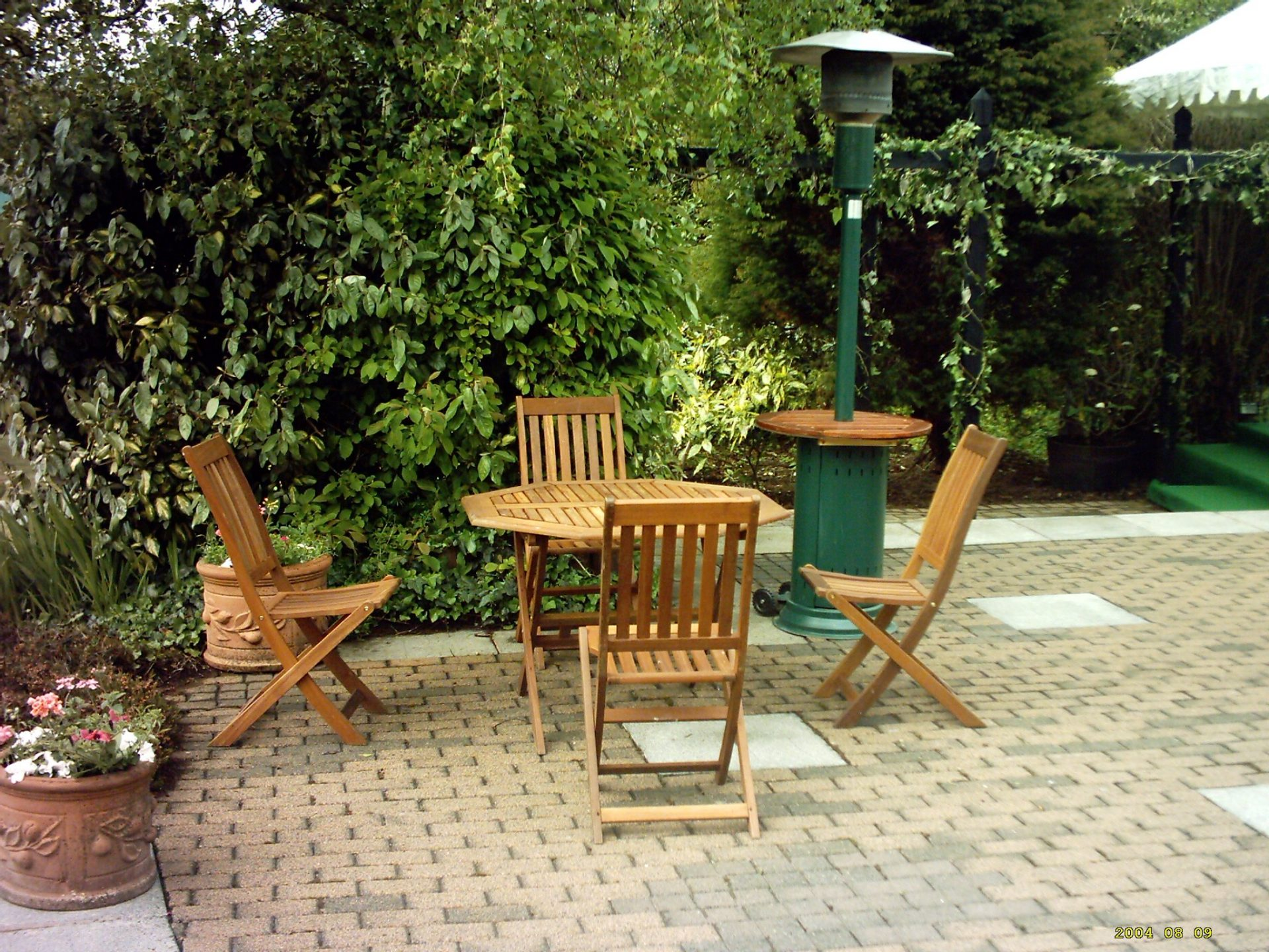 Wooden furniture with patio heater